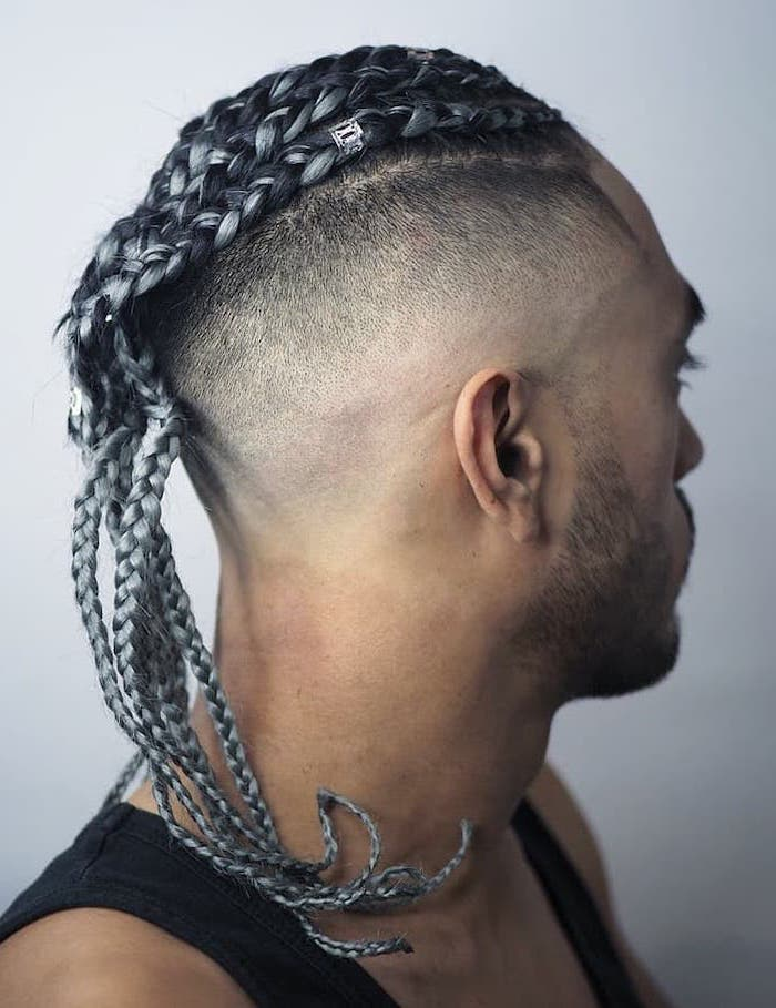 man with an undercut, black top, black hair, with ash gray highlights, braids for men