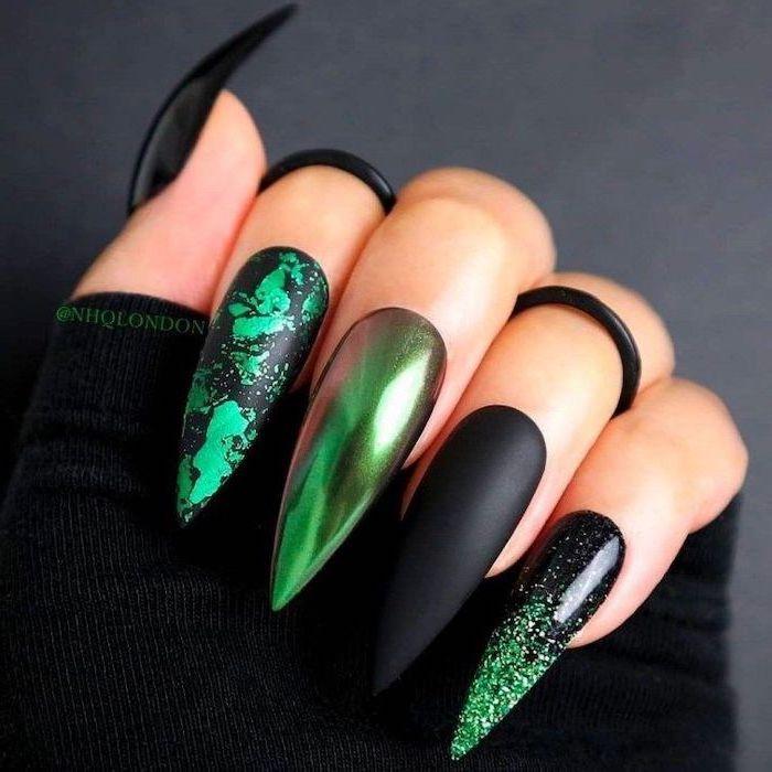 green chrome nails, black matte nails, green decorations, halloween nails, black rings, black background