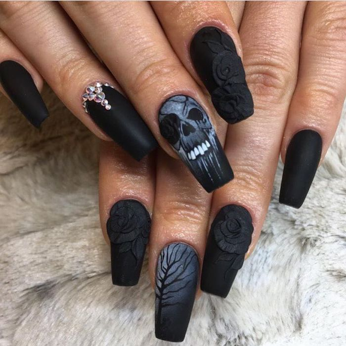 nail ideas, black matte nail polish, skulls and roses, trees decorations, silver rhinestones
