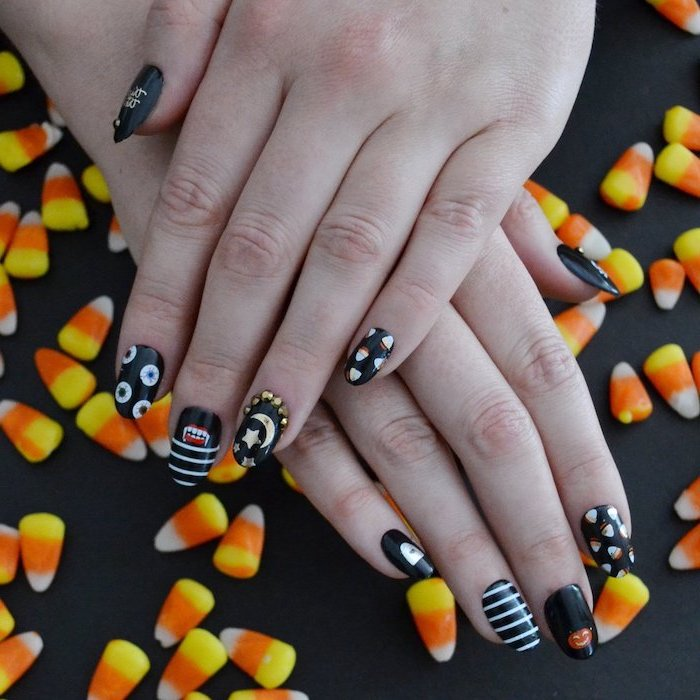 candy corn, black nail polish, nail ideas, different decorations, on each finger, squoval nails