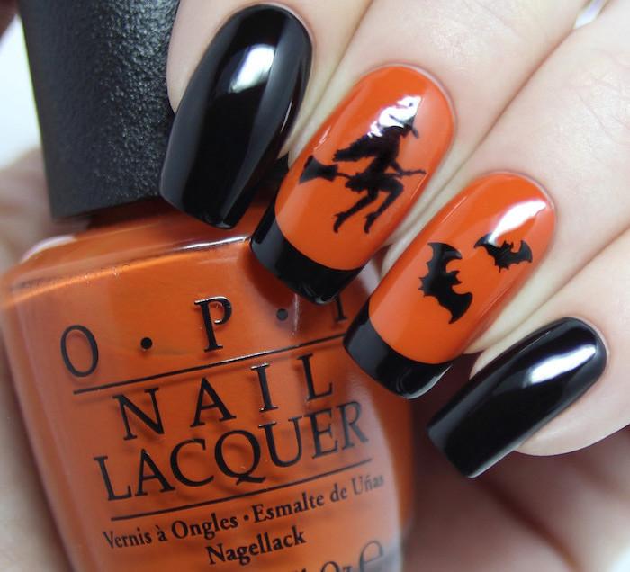 orange and black, nail polish, nail ideas, black witch and bats decorations, holding orange nail polish bottle