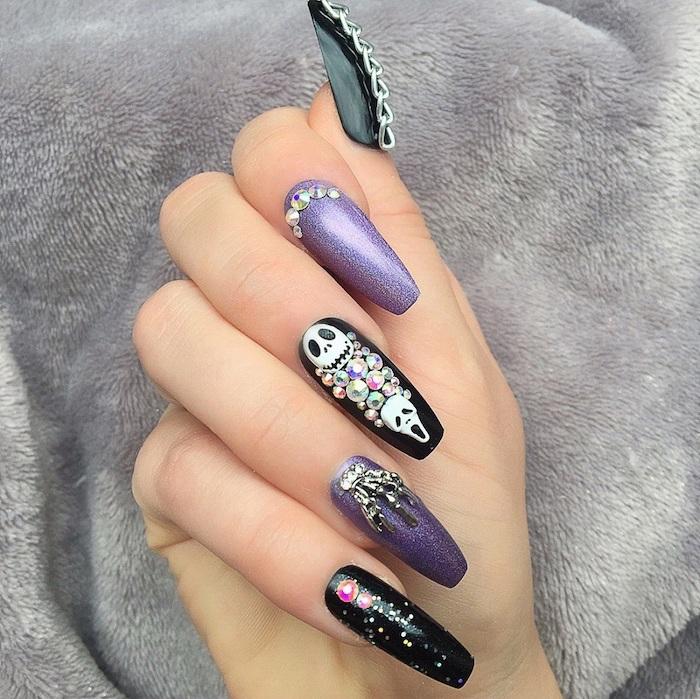 purple glitter, black nail polish, halloween nail designs, skulls and chains decorations, silver rhinestones