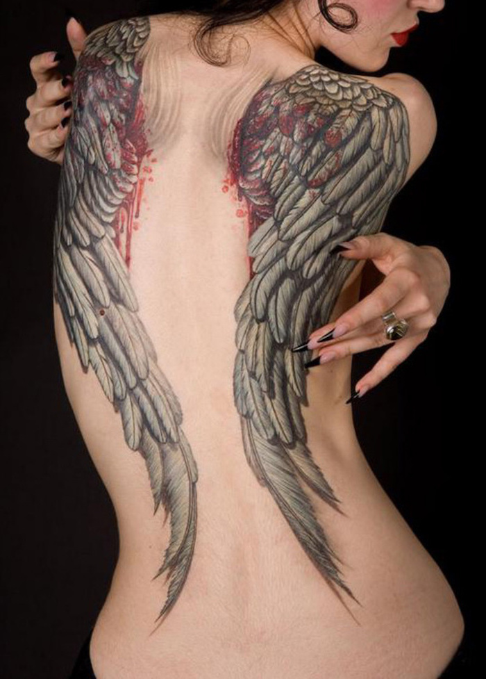 fallen angel tattoo, back tattoo, bleeding wings, woman with long, black nails, black background