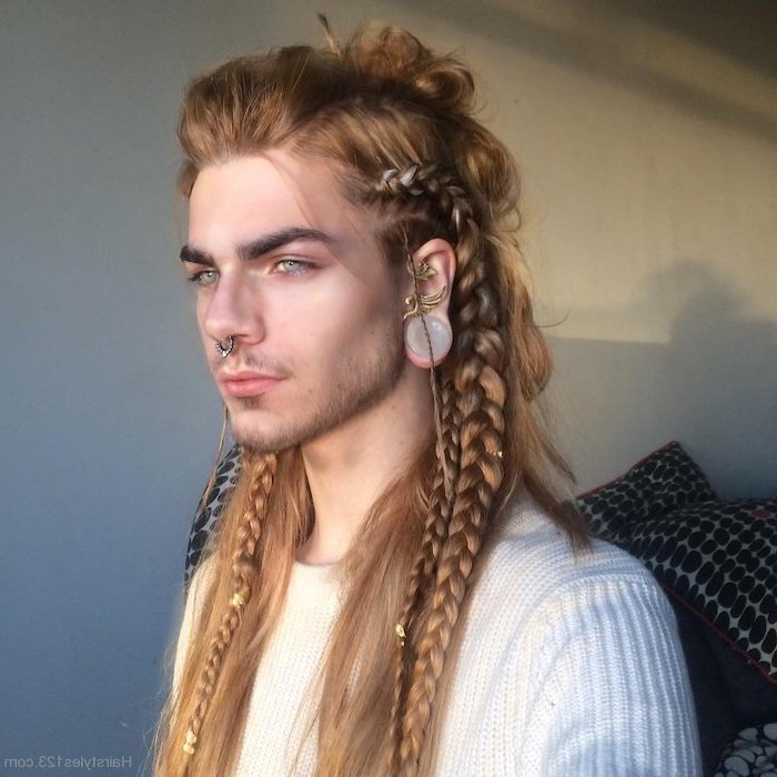 braided hairstyles, man with long, blonde hair, wearing a white sweater, nose ring