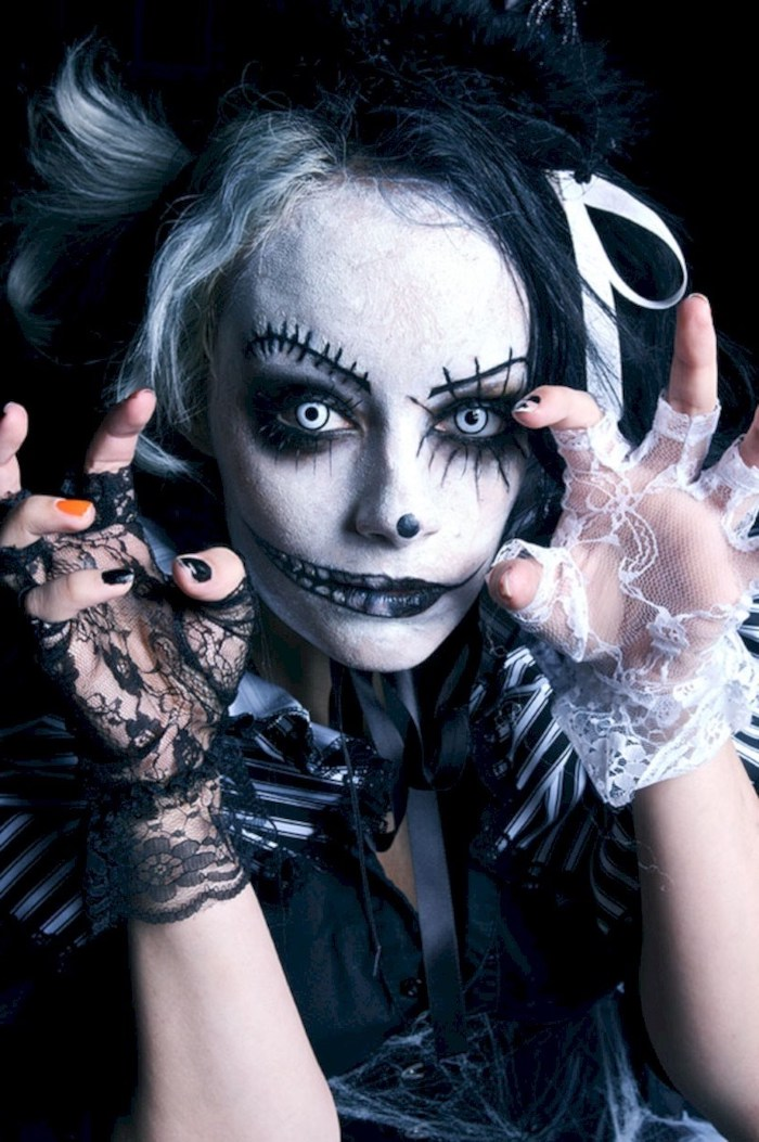 woman with scary make up, blue contact lenses, cute halloween costumes, white and black, lace gloves