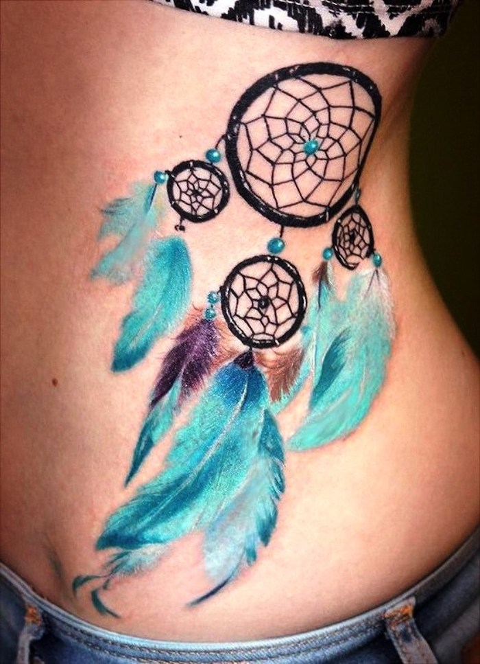 blue feathers, dreamcatcher tattoo meaning, on the side of the stomack, blue jeans