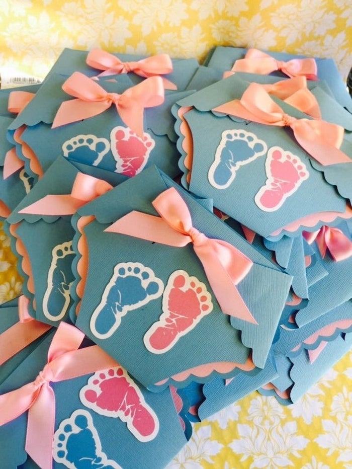 gender reveal party, diaper shaped invitations, blue and pink, baby footprints, pink bows