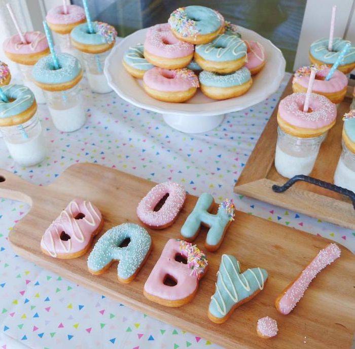 donuts and cookies, blue and pink frosting, gender reveal themes, oh baby, wooden trays