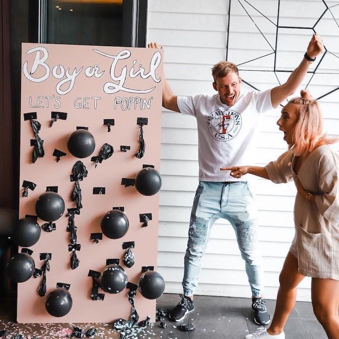 boy or girl, let's get poppin, black balloons, man and woman smiling, gender reveal ideas
