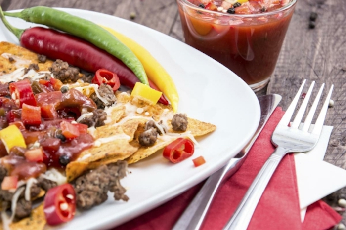 tomato juice, tortilla chips, covered in meat and salsa, nachos in white plate, best breakfast recipes