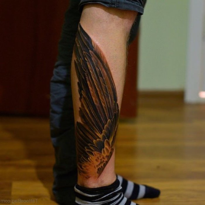 leg tattoo, brown wings, small angel wings tattoo, wooden floor, grey and black striped socks