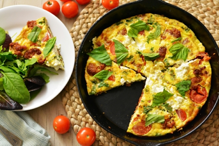 baked casserole, spinach on top, cherry tomatoes and bacon, breakfast meals