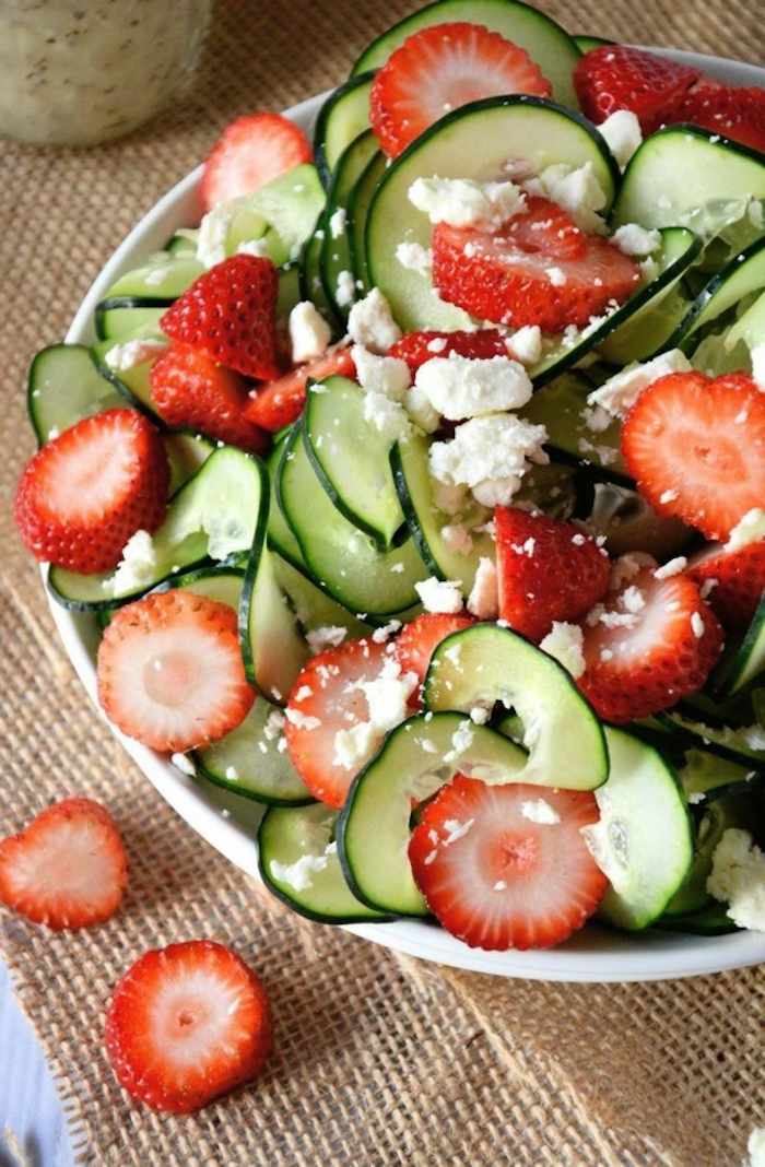 zucchini salad, with slices of strawberry, in a white bowl, garnished with cheese, brunch food ideas
