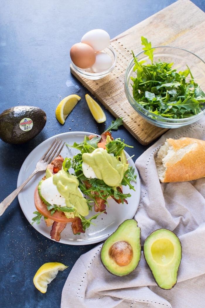bruschetta with avocado, ham and green salad, what is brunch, halved avocado, lemon slices