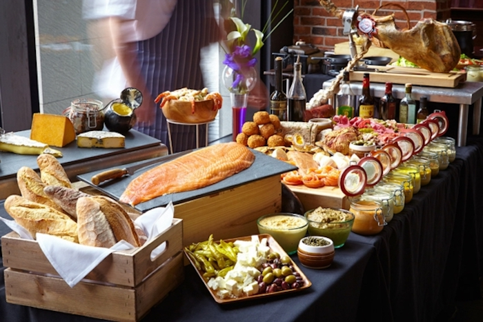 salmon fillet, cheese board, bread in a wooden crate, what is brunch, jars with different sauces