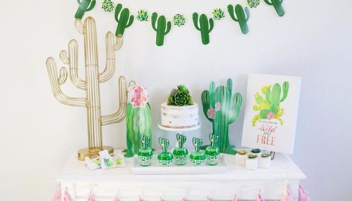 baby shower food ideas, cactus theme, wild and free, cupcakes on white plate, wooden table