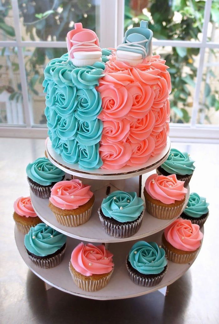 cake and cupcakes, with blue and pink frosting, gender reveal ideas, pink and blue sneakers, cake topper
