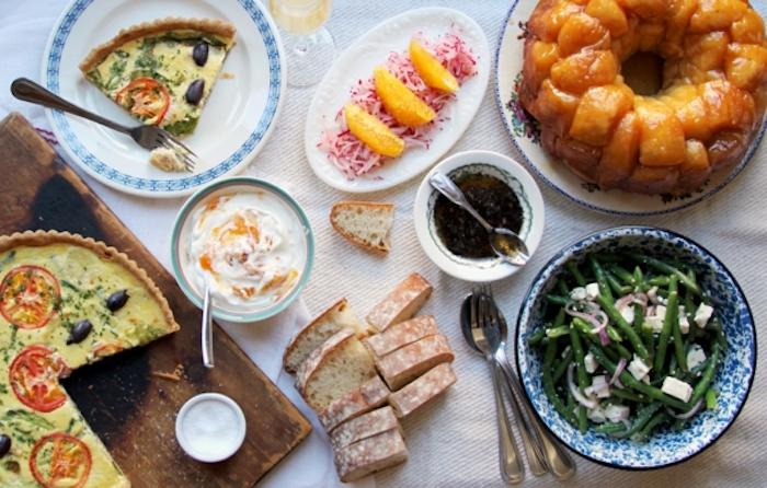 green beans salad, baked casserole, breakfast dishes, lemon slices, sliced bread, brunch table