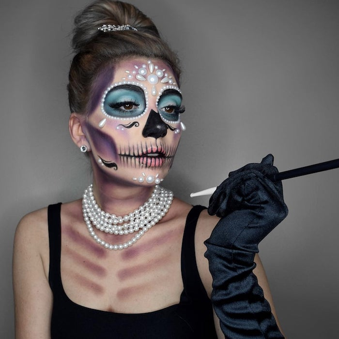 woman with calavera makeup, halloween costume ideas, wearing white pearls, black satin gloves, black dress