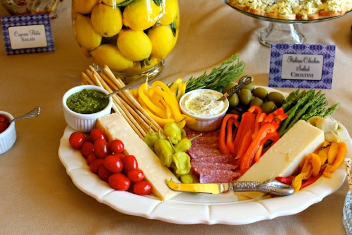 cheese platter, brunch menu ideas, cherry tomatoes, salami and olives, chopped peppers