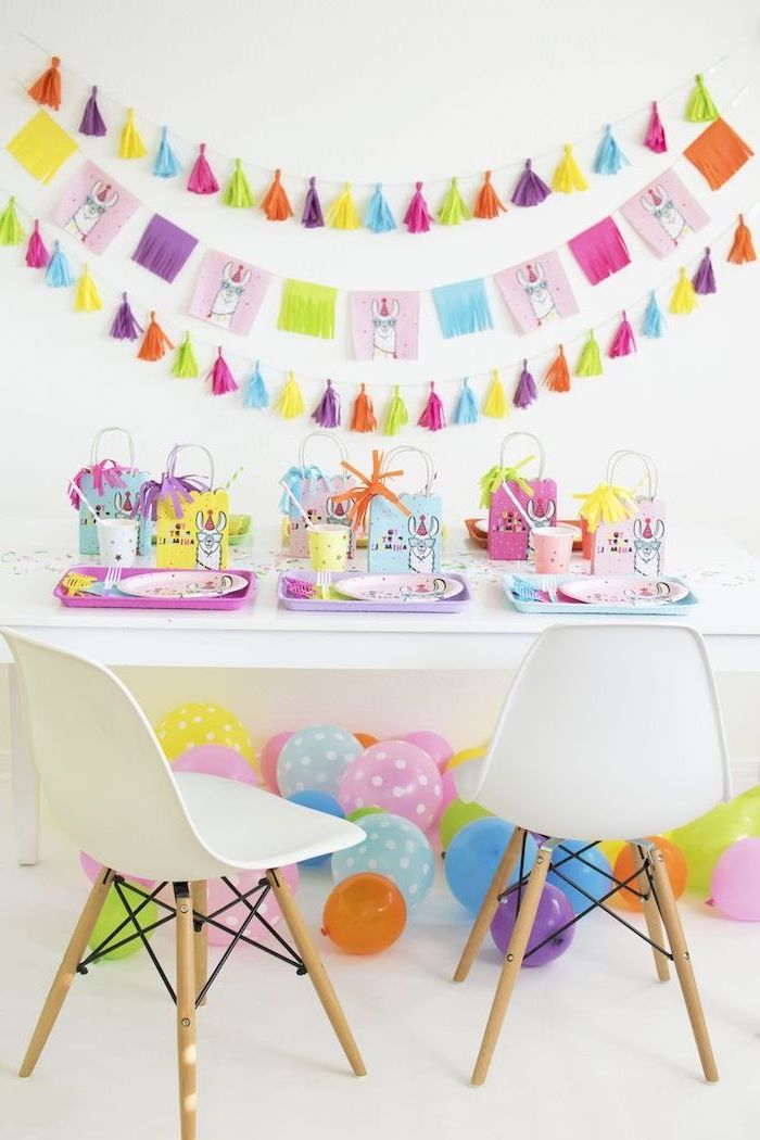 baby shower decorations, colorful decorations, white chairs, llama theme, colorful balloons, tassel garland