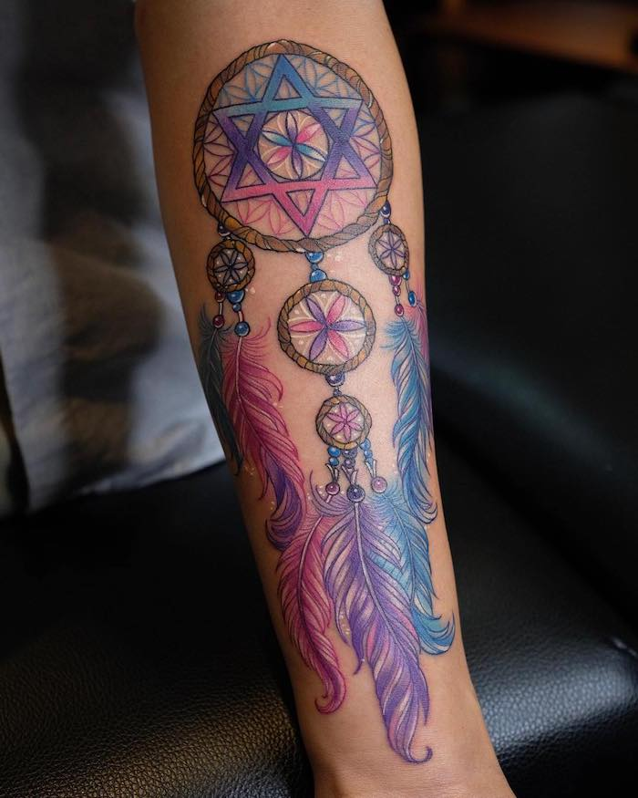 purple pink and blue colors, forearm tattoo, dreamcatcher meaning, black leather chair