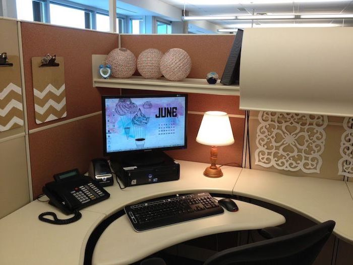 hanging folders, desktop computer, cubicle wallpaper, black chair, desk lamp