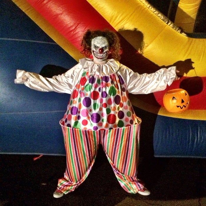 man dressed as clown, scary clown mask, cute halloween costumes, bouncy castle