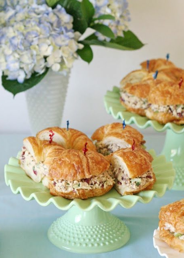 halved croissants, with filling, on green cake stands, brunch menu ideas, flower bouquet