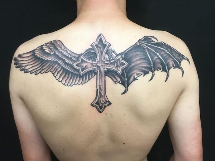 one angel wing, one devil wing, cross in the middle, back tattoo, small angel wings tattoo, black background, angel and devil wings tattoo