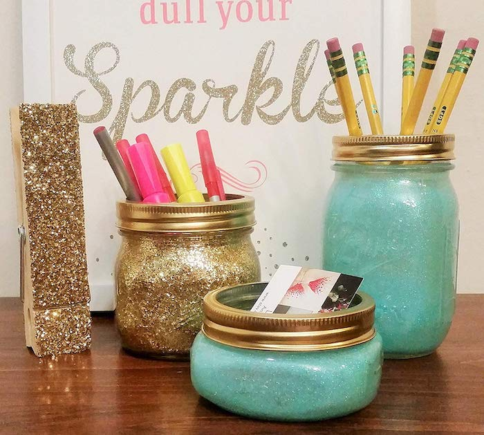 mason jars, covered in blue and gold glitter, gold glitter peg, cubicle wallpaper, wooden desk