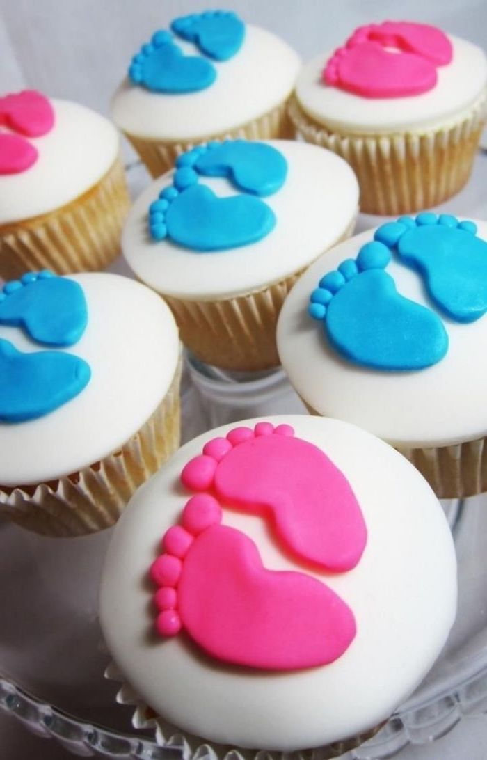 gender reveal party ideas, small cupcakes, white frosting, pink and blue, baby footprints, made of fondant