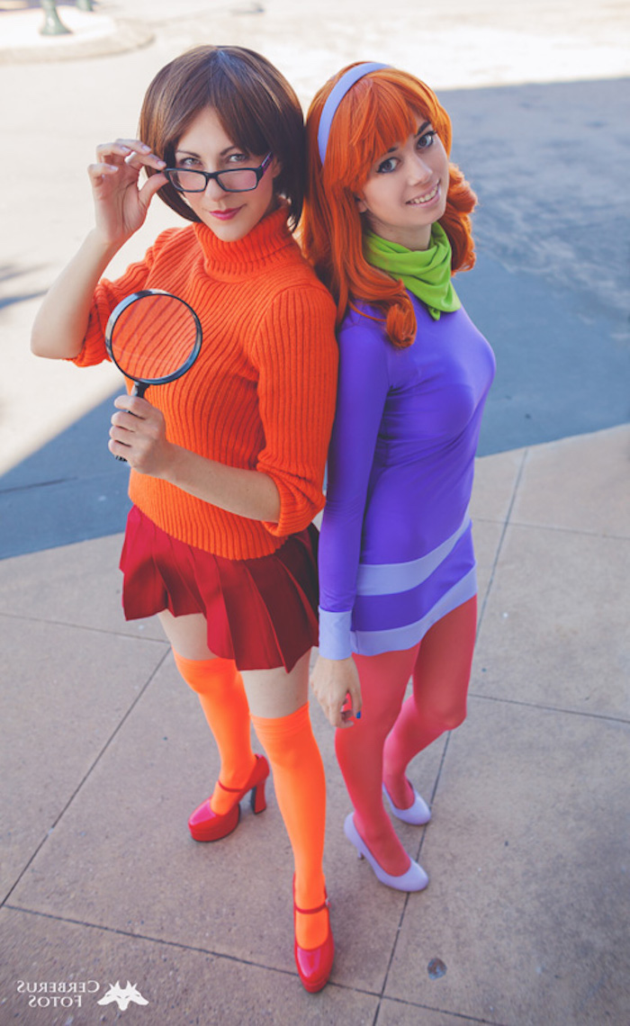 two women, dressed as daphne and velma, halloween costume ideas, scooby doo cartoon, inspired costumes
