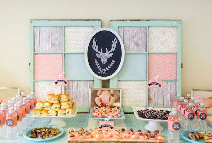 colorful decor, in pastel colors, baby shower food ideas, burgers and pretzels, cupcakes and cookies, water bottles