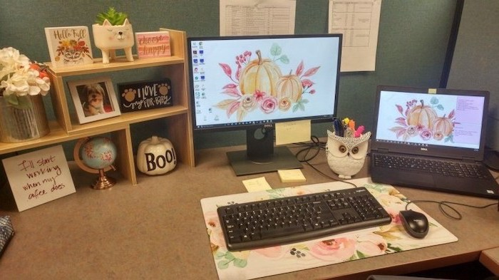 desktop computer and laptop, cubicle wallpaper, floral keyboard pad, wooden desk organiser, flower bouquet
