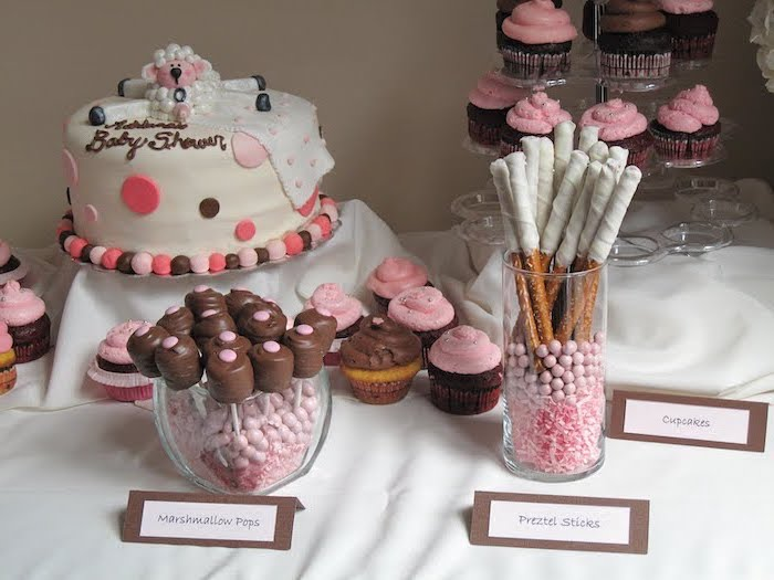 girl baby shower, cake with white fondant, sweet pretzels, cupcakes and marshmallow pops