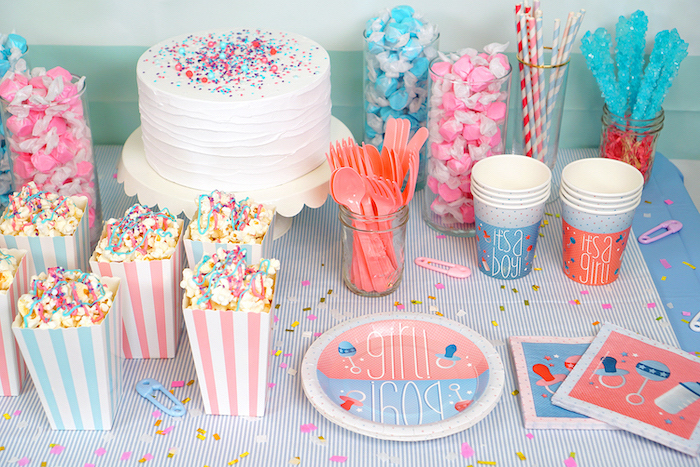 sweet popcorn, pink and blue candy, gender reveal party ideas, white cake frosting, sprinkles on top