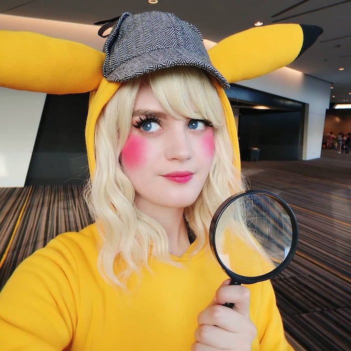 detective pikachu, halloween costumes, woman with blonde hair, holding a magnifying glass, rosy cheeks