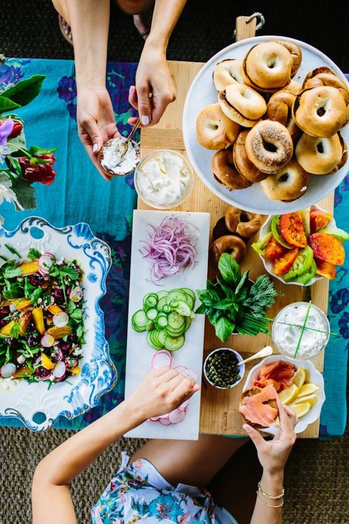 halved bagels, easy brunch recipes, chopped vegetables, green salad, sour cream