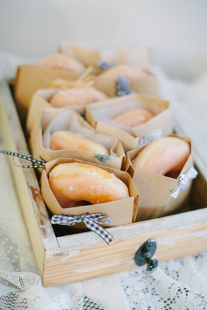 donuts in paper, white and black bows, in a wooden crate, easy brunch recipes