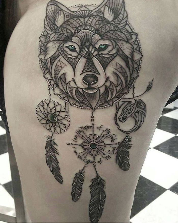 thigh tattoo, wolf dreamcatcher tattoo, black and white, tiled floor, inspirational quote