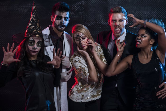 group of people, dressed with different costumes, halloween costumes, posing for a photo