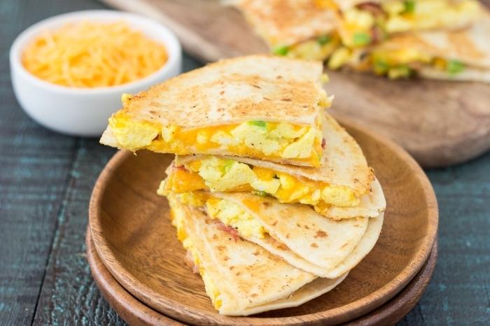 eggs and avocado, between tortillas, easy brunch recipes, wooden plates, wooden table