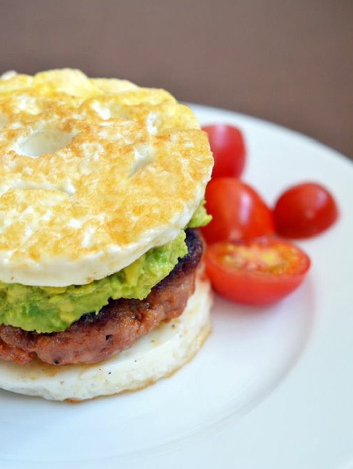 chopped cherry tomatoes, great breakfast ideas, eggs with avocado, beef burger in the middle
