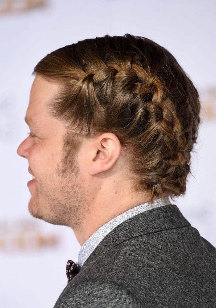 eldon henson, side french braid, box braids men, wearing a gray blazer, blonde hair