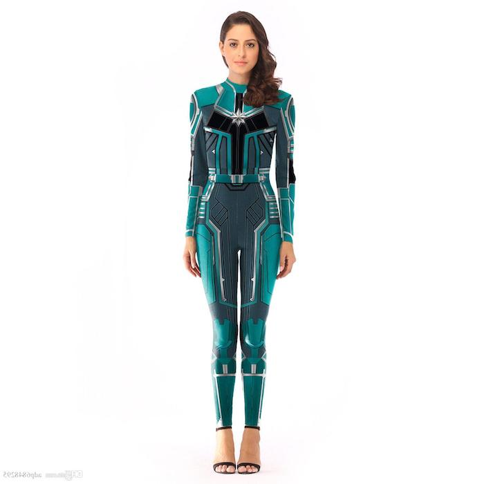 woman dressed as captain marvel, turquoise suit, couples halloween costume ideas, white background