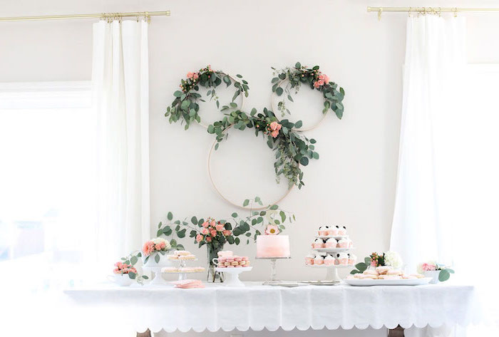 floral wreaths, on white wall, dessert table, dinosaur baby shower, cake and cupcakes, flower bouquets