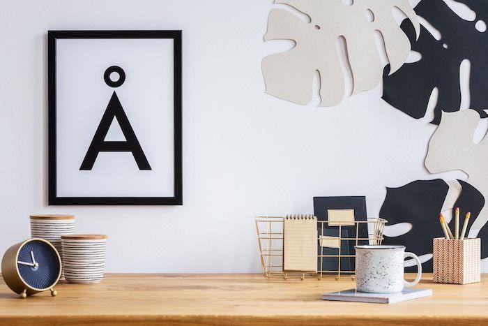 framed art, wooden desk, gold metal basket, desk decor ideas, metal coffee mug, small clock
