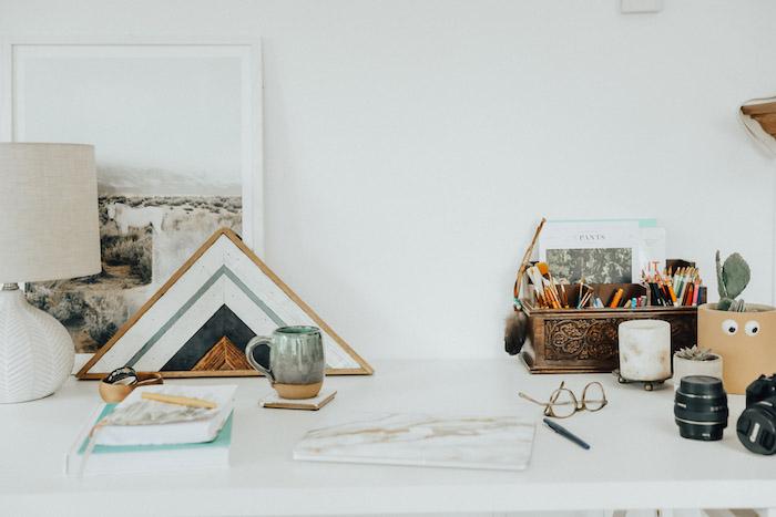 desk decor ideas, white wall, vintage pencil holder, on white desk, wooden desk organiser, notebooks and books