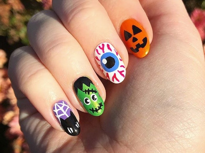 different decorations, red nails coffin, squoval nails, frankenstein and eye, cat and pumpkin